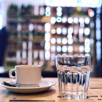 Image of espresso with cup of water | what's the difference between water filtration and water purification